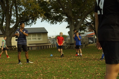 PNBHS staff member Lifeimi Mafi assisting with the PNBHS Holiday Sports Programme for Intermediate aged kids